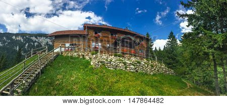 The famous cottage refuge Curmatura, in Piatra Craiului, mountain of Transylvania, in Zarnest Romania