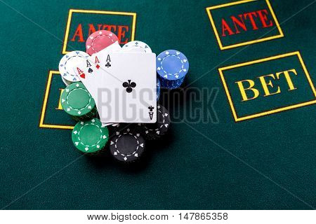 Poker chips on a poker table at the casino. Closeup. four aces, a winning combination. Chips winner