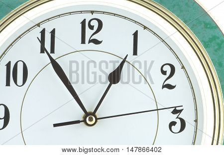 Almost one hour on big wall clock part isolated on white close up