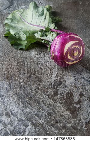 Ripe Purple Turnips With Green Leaves. Grey Stone Background. Au