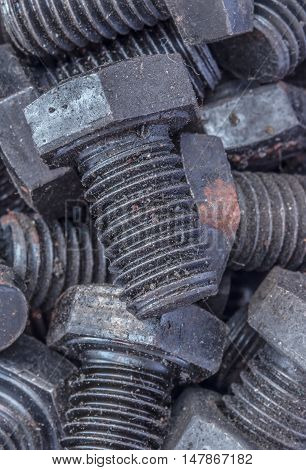 Close-up of various steel nuts and bolts.