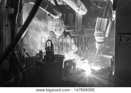 Welding robots movement in a car factory industry