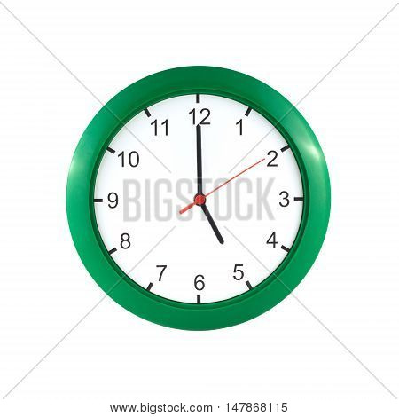 Five o'clock on big wall clock in green case isolated on white close up