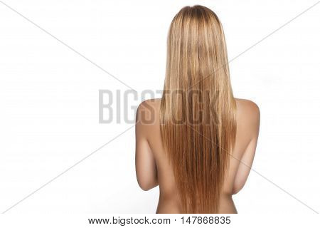 Long Hair On The Back Of A Beautiful Girl On A White Background In Studio
