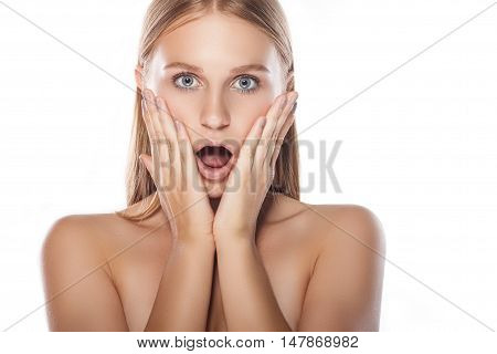 Young Woman Surprised And Put Her Hands To Her Face. Woman On A White Background