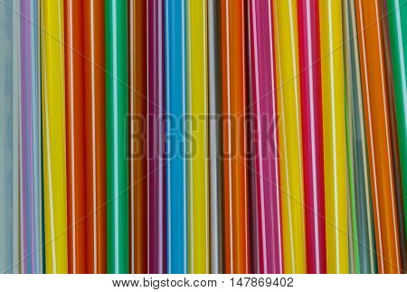 The Closeup Multi Color flexible straws on background.