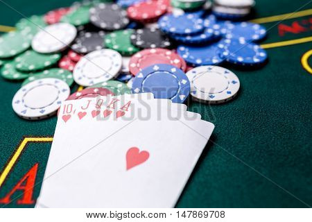 Poker chips on a poker table at the casino. Closeup. royal flush, winning combination. Chips winner