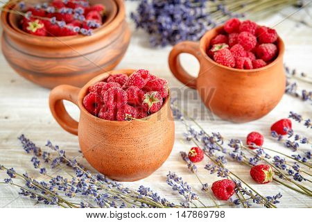 breakfast with raspberries on wooden table - rustic stile