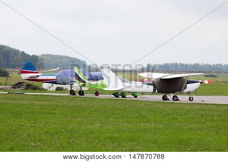 Private jet is parked on a summer day