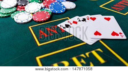 Poker chips on a poker table at the casino. Closeup. quads, a winning combination. Chips winner