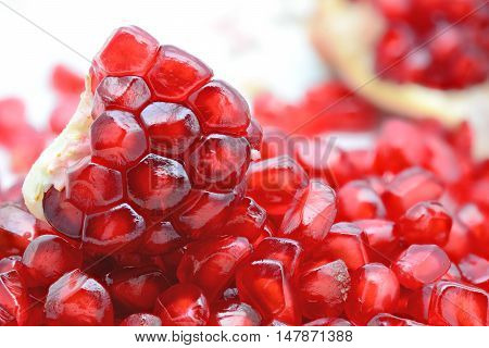 Fresh peeled pomegranates and red pomegranate seeds