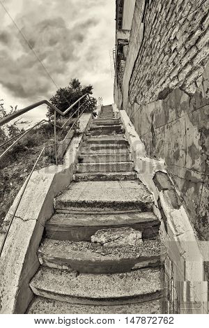 Old Stairs With Cracked, Uneven Concrete Stairs