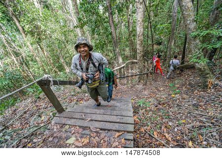 Semporna,Sabah-Sep 10,2016:A group of friends hike up a trail in Bohey Dulang,Tun Sakaran Marine Park,Semporna,Sabah,Borneo.It is the most popular island for hiking & climbing activities.