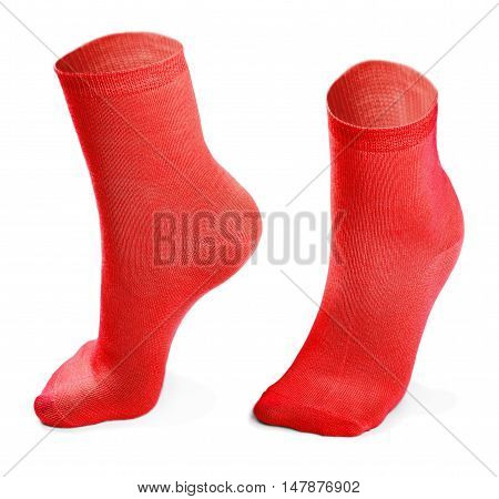 red pair of socks isolated on white background. Imitation feet walking steps