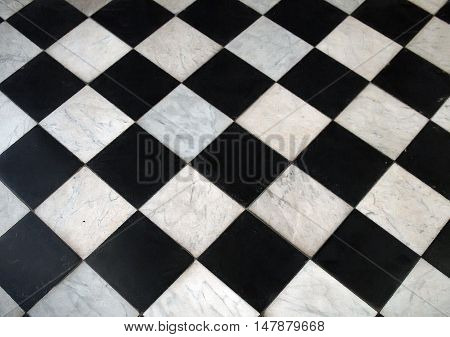 Black and white checkered marble floor pattern background