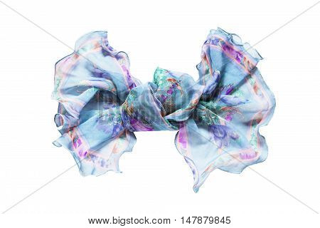 Blue chiffon kerchief knotted on white background
