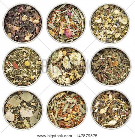 collection of nine herbal blend Chinese tea in round metal cans, top view isolated on white