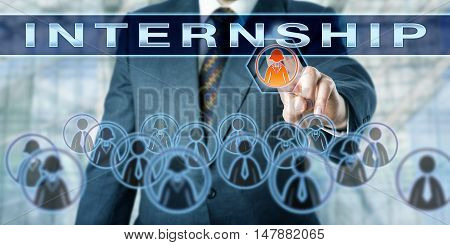 Unrecognizable businessman is selecting one female white collar worker amidst a crowd for an INTERNSHIP. Employment concept and business metaphor for temporary job training for professional careers.