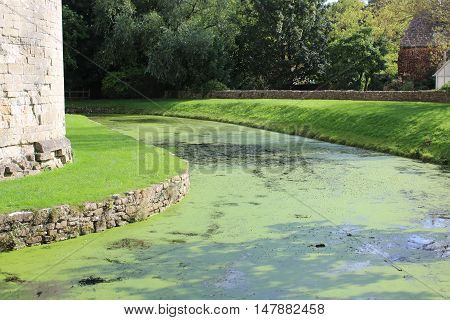 Abandoned castle moat on a sunny day