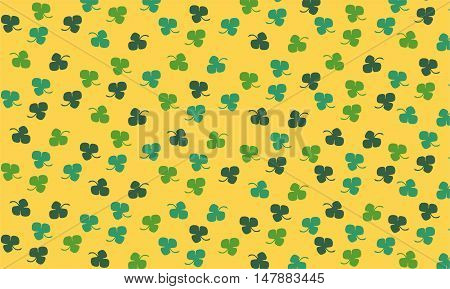 A green clover pattern on yellow background