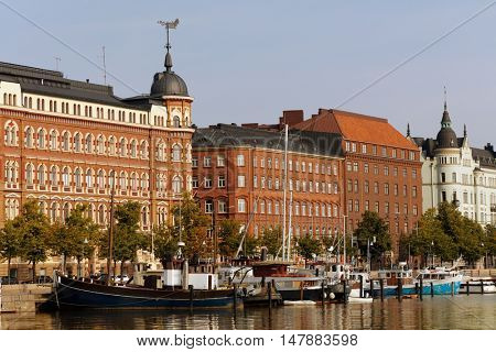 HELSINKI, FINLAND - AUGUST 21, 2016: Boats moored at Pohjoisranta waterfront. The name of the area means North Beach and come from 17th century when the entire port of Helsinki was located here