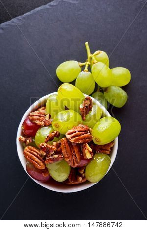 Juicy sultanas grapes and pecan nuts snack.