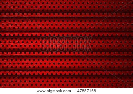 Metal background. Red perforated texture. Vector illustration