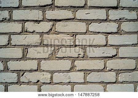Old wall from a white brick background