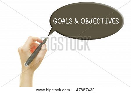 Woman hand writing Goals and Objectives with a marker isolated on white.