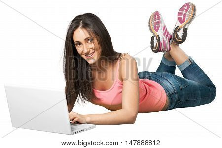 Young woman lying down in front of a laptop
