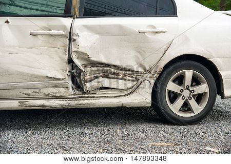 A white car in an accident background.