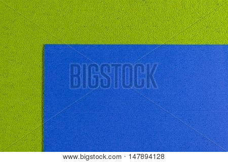 Eva foam ethylene vinyl acetate blue surface on apple green sponge plush background