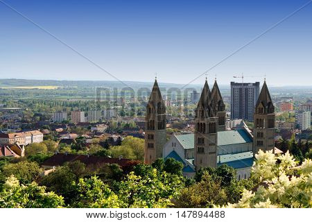 cityscape of Pecs in Hungary wih large church.