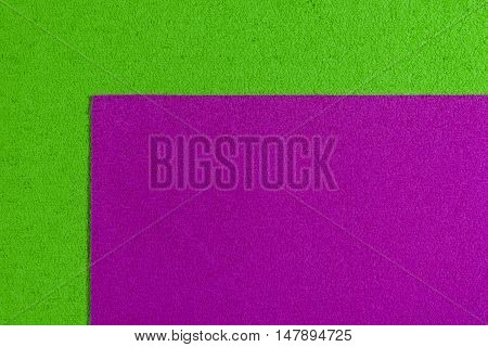 Eva foam ethylene vinyl acetate pink surface on apple green sponge plush background