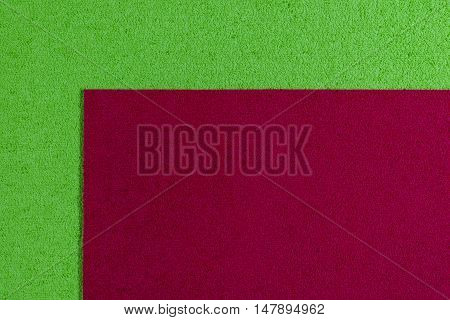 Eva foam ethylene vinyl acetate red surface on apple green sponge plush background