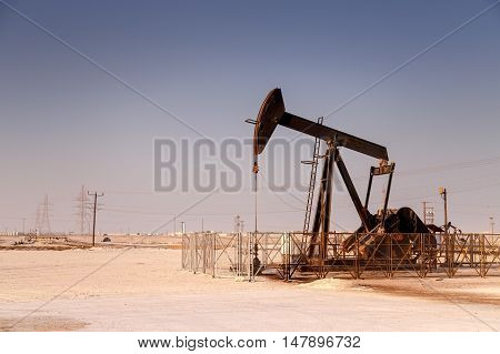View of a Typical oil pump jack from an oil field in Bahrain