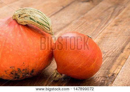 Detail of Hokkaido Pumpkins on wooden background