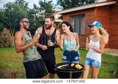 Group of young cheerful happy teens having fun at the picnic area