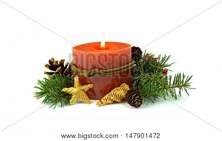 Little Christmas composition a burning candle fir cones straw toys decorative red berries. / Isolation on a white background /. In anticipation of the holiday. Simple rustic style the gifts of nature for the decoration.