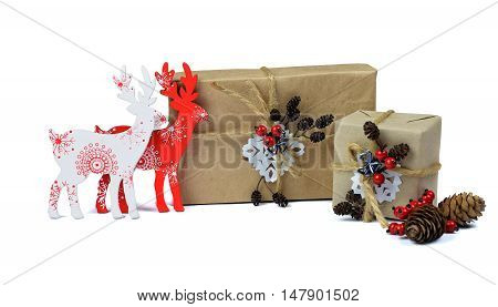 Christmas composition with present boxes red berries deer and fir-cones on white background. Christmas card with christmas rustic decorations. /isolated on white background /