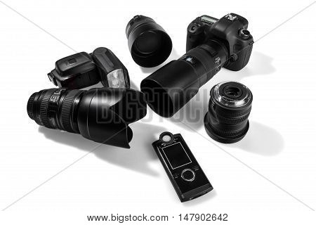 Digital SLR Camera with multiple lenses, flash and a light meter