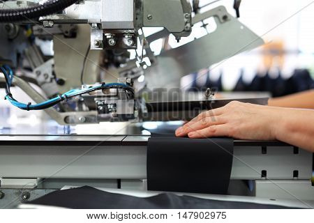 production plant, sewing clothes by seamstresses on the sewing machine