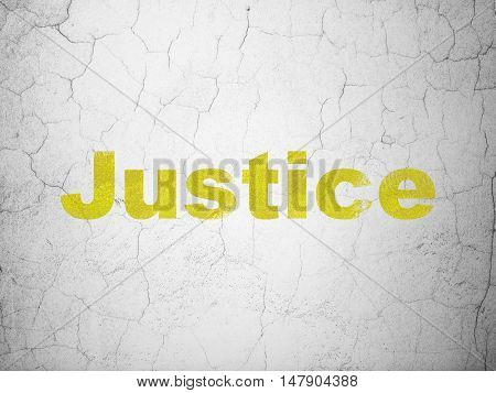 Law concept: Yellow Justice on textured concrete wall background