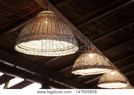 beautiful woven decorative chandeliers in ethno restaurant.