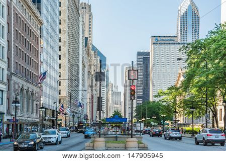 Chicago, USA - May 30, 2016: Divided street with traffic on South Michigan Avenue in downtown with cars and skyscrapers.