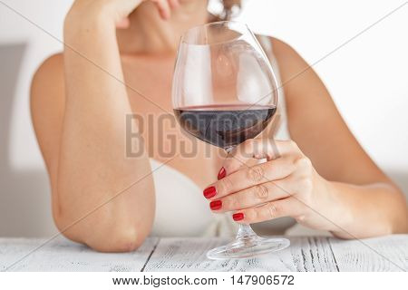 Red Wine. Woman Drinking Red Wine In Bedroom. White Background.
