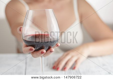 Woman Enjoying Red Wine Savouring The Bouquet