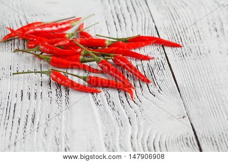 Some Red Hot Chilly Peppers On A Wooden Table