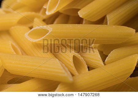 Penne Italian pasta. Raw Penne. Italian Pasta.