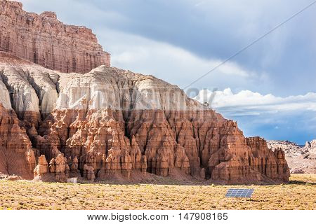 Goblin Canyon with white and red layers with solar panel in desert, Utah